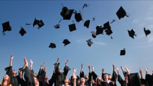 Graduates tossing caps in the air