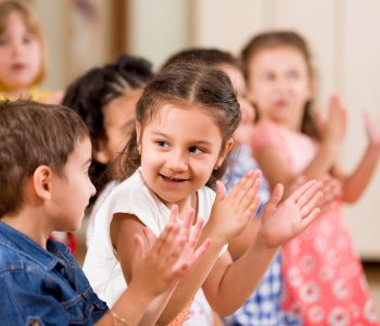 Preschool children clapping