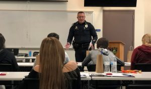 Sargent Charles Hernandez of the Flagstaff Police Department speaks with a group of high school students
