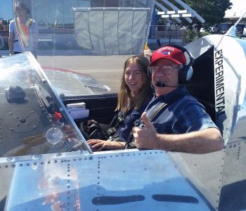 Student pilot with instructor in airplane