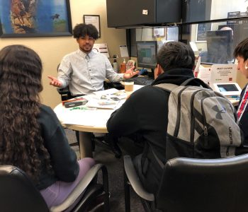 A banker at Wells Fargo in Flagstaff speaks with students from Summit High School about financial literacy