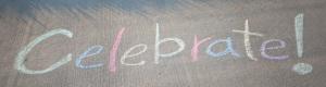 Celebrate! written on a sidewalk in chalk