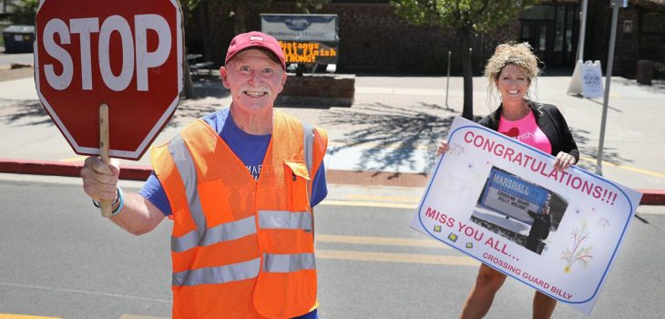 Crossing guard Billy Weldon stands in front of Marshall Elementary School