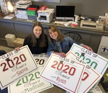 Print shop owners display class of 2020 graduate signs