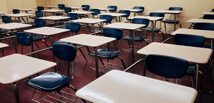 high school classroom with empty desks